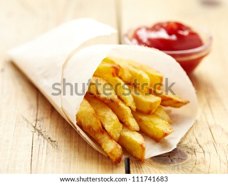 French fries with ketchup - stock photo