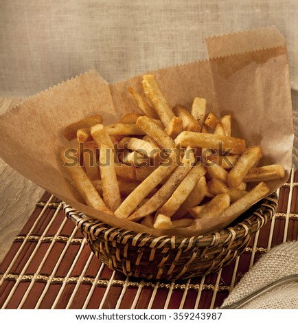 French fries with wooden basket - stock photo