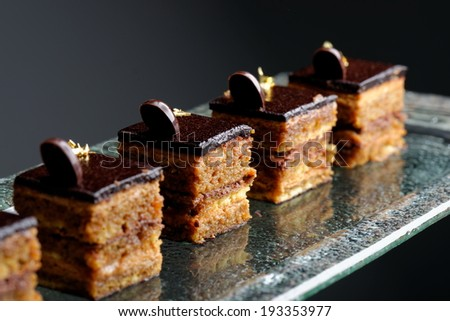 French gourmet coffee cake with real gold leaves  - stock photo