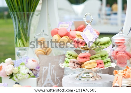 French macaroons on a cake stand . Candy bar on wedding. - stock photo