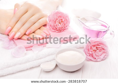 french manicure with essential oils, rose flowers. spa - stock photo