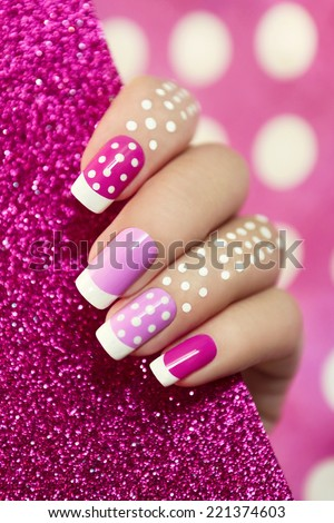 French manicure with pink shades and white dots on a brilliant background. - stock photo