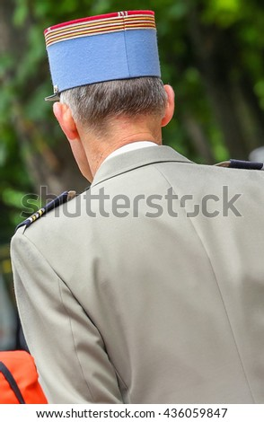 French military cap with a flat top and horizontal brim - stock photo