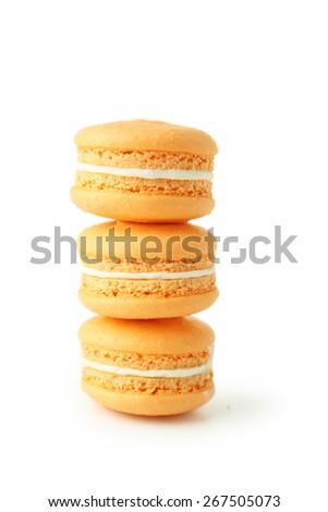 French orange macarons isolated on white - stock photo