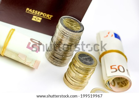 French Passport and currency focuses on Euro banknotes - stock photo