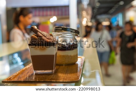 French pastries on display a confectionery shop. - stock photo