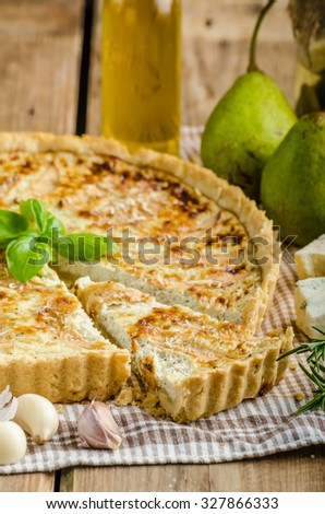 French quiche stuffed with blue cheese and pears, very delicious and tasty cake - stock photo