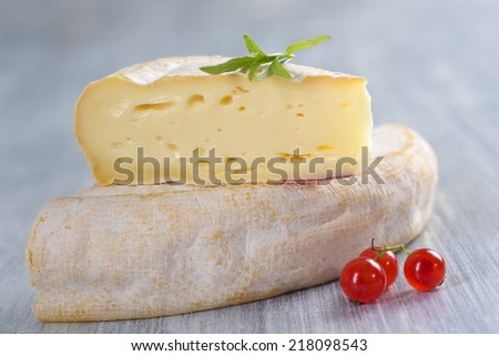 French Reblochon cheese from Savoy region - stock photo