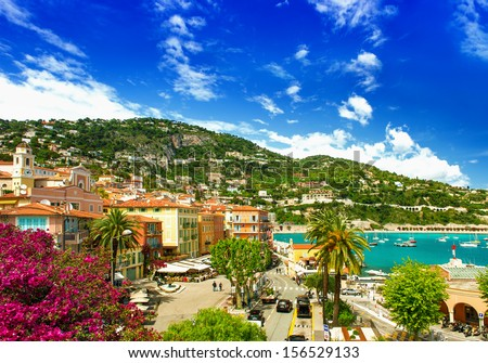 french riviera, view of luxury resort and bay of Villefranche-sur-Mer near Nice and Monaco. mediterranean sea landscape with azalea flowers - stock photo