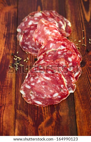 french salami with black peppercorn and fennel spices - stock photo