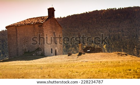 french stone church in countryside - stock photo