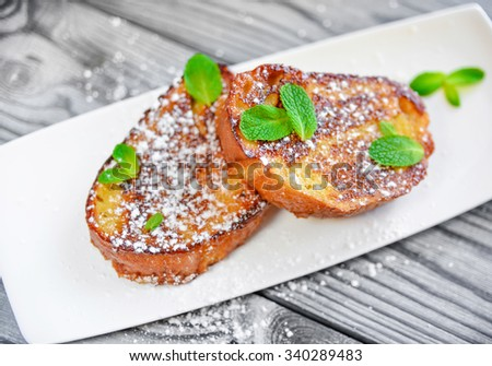French toast -  fried bread toast with powdered sugar and mint - stock photo
