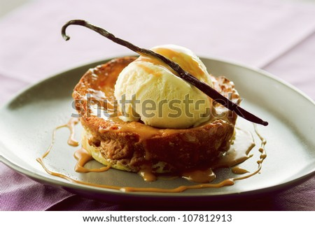 French toast-style brioche with vanilla ice cream and toffee sauce - stock photo