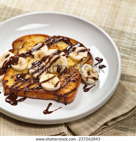 French Toast with Bananas and Chocolate sauce. Selective focus. - stock photo