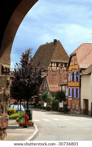 French traditional house with half-timbered wall. La route du vin , route of vines, village in Alsace - France. Dambach la ville. - stock photo