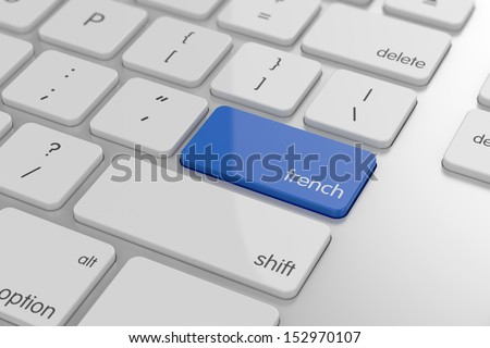 French translation button on keyboard with soft focus  - stock photo