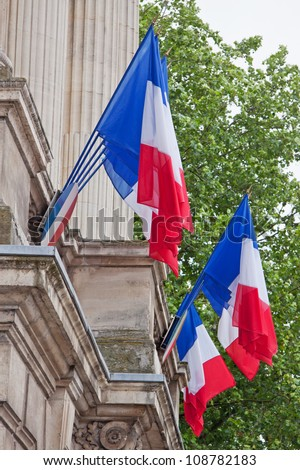French tricolours decorate a local government building in Lille, France on the eve of Bastille Day celebrations - stock photo