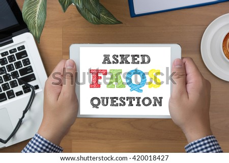 Frequently Asked Questions Faq Feedback  Concept man hand Tablet with blank - stock photo