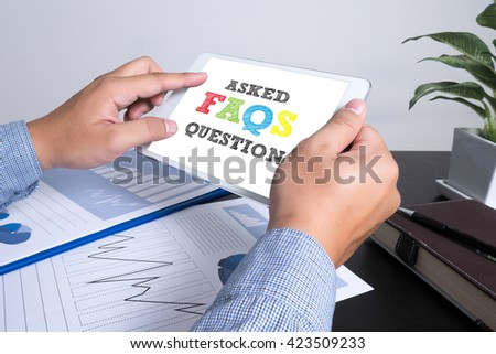 Frequently Asked Questions Faq Feedback  Concept man using tablet computer, Marketing data paper3 - stock photo