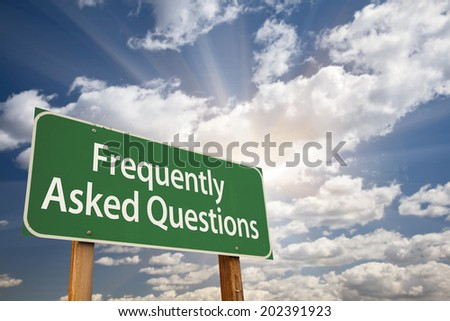 Frequently Asked Questions Green Road Sign with Dramatic Clouds and Sky. - stock photo