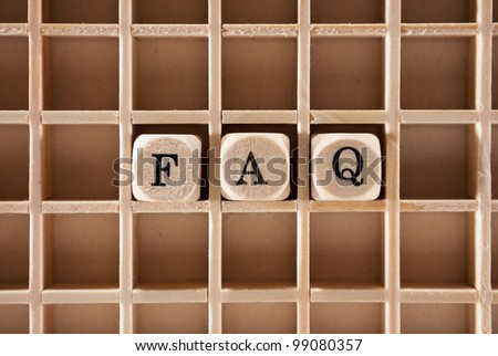 Frequently asked questions or FAQs letter cubes with a shallow depth of field - stock photo