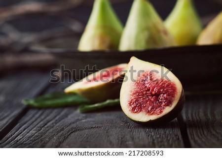 Fresg figs on wood. Fresh fruit on black - stock photo