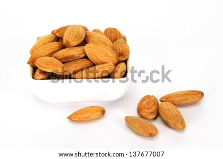 Fresh almonds in a bowl - stock photo