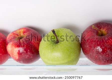 Fresh and clean apples on the refrigerator shelf. good to eat in diet. - stock photo
