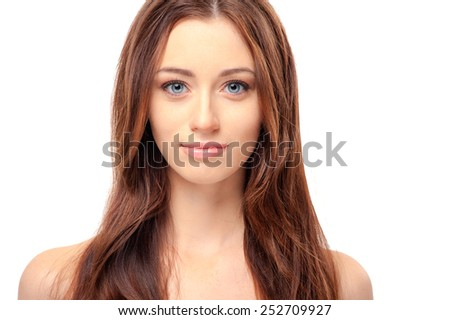 Fresh and clean. Portrait of beautiful young caucasian shirtless woman with long brown hair looking at camera while standing on white background - stock photo