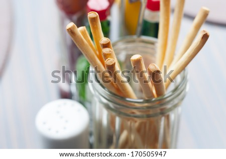 fresh and crunchy breadsticks on the table in restaurant - stock photo