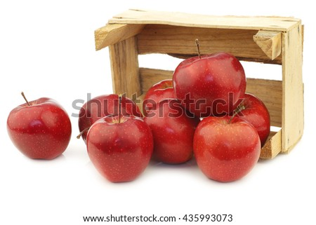 Fresh and delicious red Jonagold apples in a wooden crate  on a white background - stock photo