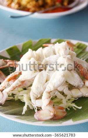 Fresh and delicious steamed or boiled crab paddle-leg, seafood cuisine. - stock photo
