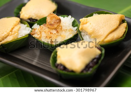 Fresh and delicious sticky rice with sweet custard for local Thai dessert background - stock photo