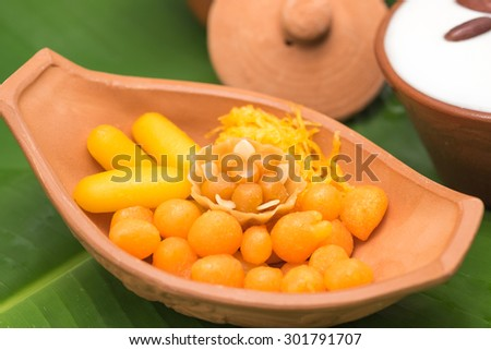 Fresh and delicious Thai local sweet snack or dessert on banana leaf for food background  - stock photo