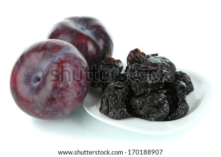Fresh and dried plums, isolated on white - stock photo