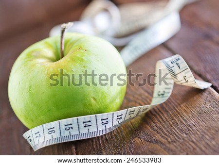 fresh and green apple on the wooden table - stock photo