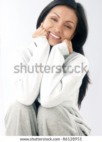 fresh and happy latin woman portrait in white sweater. - stock photo