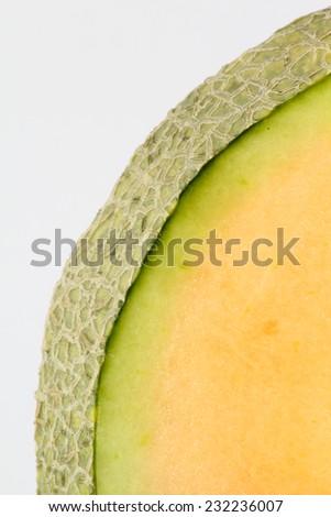 Fresh and juicy cantaloup slice on white background. - stock photo