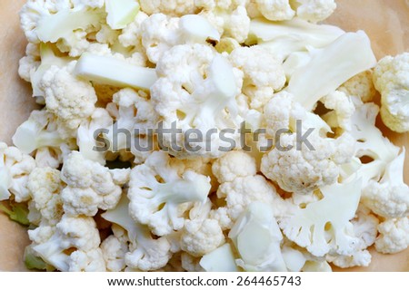 Fresh and raw white cauliflower on wooden table - stock photo