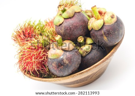 Fresh and ripe rambutan and mangosteen in bamboo basket for tropical fruits background - stock photo