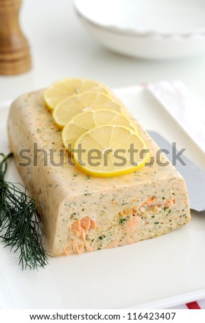 Fresh and smoked salmon terrine garnish with lemon - stock photo