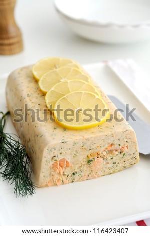 Fresh and smoked salmon terrine garnish with lemon - stock photo