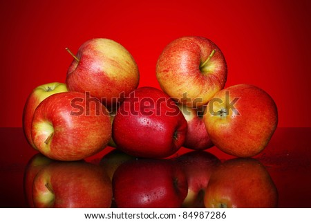 Fresh and tasty apples against red gradient - stock photo