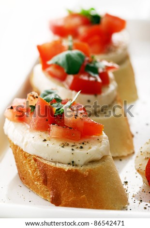 Fresh and tasty bruschetta over white background - stock photo