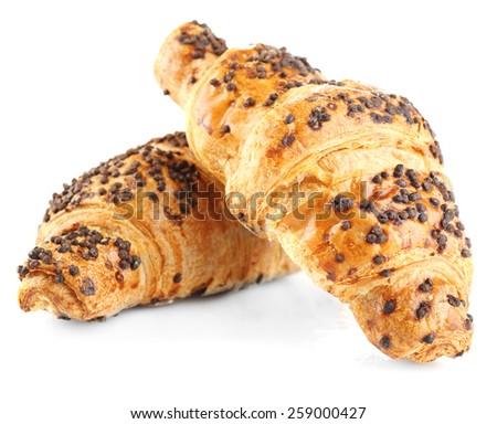 Fresh and tasty croissants with chocolate, isolated on white - stock photo