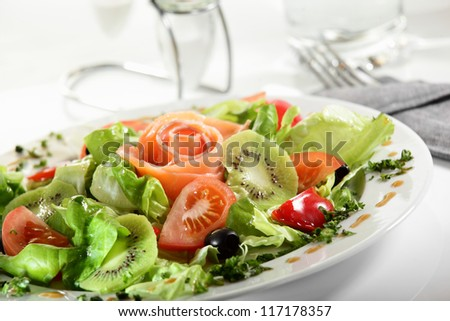 fresh and tasty european salad on white dish - stock photo