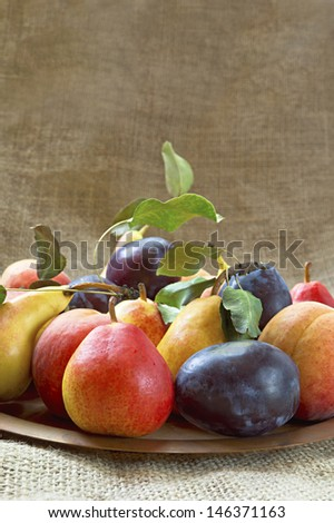 Fresh and tasty fruit on a plate. Selective focus with shallow depth of field. - stock photo