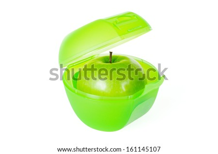 Fresh and tasty green apple in a school lunch box - stock photo