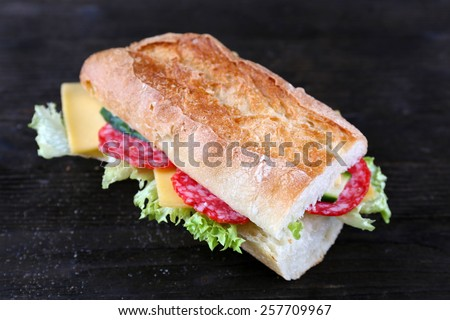 Fresh and tasty sandwiches with cheese and vegetables on wooden background - stock photo