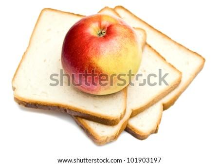 fresh apple and toasts on white - stock photo